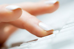 Female hand typing. Royalty Free Stock Photography