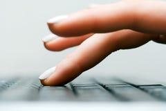 female hand typing стоковое изображение
