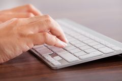 Female hand typing on keyboard Stock Photography