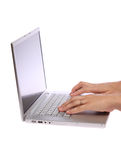 Female hand typing on laptop Stock Images