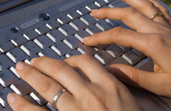 Female hand typing on laptop Royalty Free Stock Image