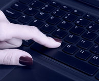 Female hand using computer keyboard Royalty Free Stock Images