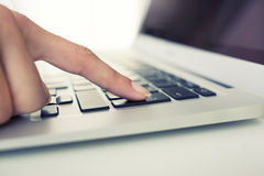 Female hand using computer keyboard, enter button Royalty Free Stock Photos
