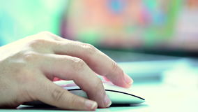 Female Hand Using a Computer Mouse. With laptop screen background. Ultra HD 3840x2160 Video Clip stock video