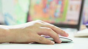 Female Hand Using a Computer Mouse ,with laptop screen background. Ultra HD 3840x2160 Video Clip stock video