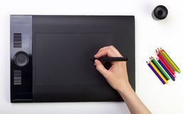 Female Hand Using Graphic Tablet. Creativity Royalty Free Stock Photography