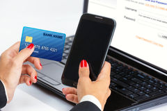 Female hand,using internet card for e-banking. Royalty Free Stock Photos