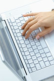 Female hand using laptop stock photos