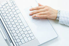 Female hand using laptop Royalty Free Stock Images