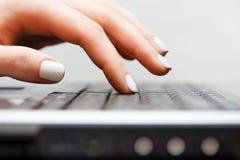 Female hand using laptop Royalty Free Stock Image