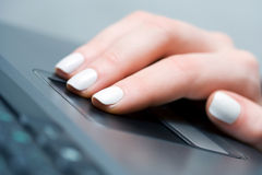 Female hand using laptop Stock Photo