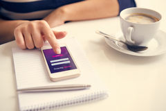 Female hand using mobile banking Royalty Free Stock Image
