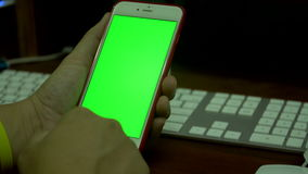 Female hand Using a Smart Phone with a Green Screen.  stock video footage