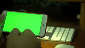 Female hand Using a Smart Phone with a Green Screen.  stock footage