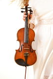 Female hand with a violin outdoor Royalty Free Stock Photos