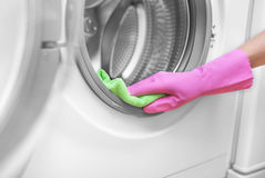 Female hand wash washing machine. Royalty Free Stock Images