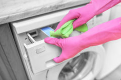 Female hand wash washing machine. Royalty Free Stock Photos