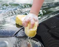 Female hand washing car Royalty Free Stock Image