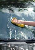 Female hand washing car Royalty Free Stock Images