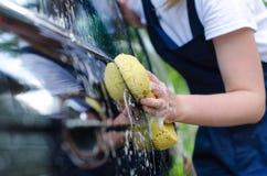 Female hand washing car Royalty Free Stock Photography