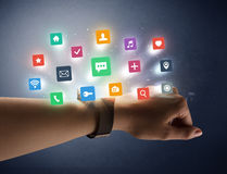 Female hand wearing smartwatch with app icons Royalty Free Stock Photo