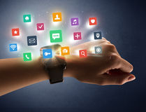 Female hand wearing smartwatch with app icons Royalty Free Stock Photography