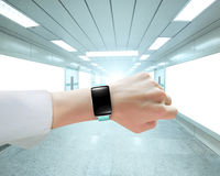 Female hand wearing smartwatch blank black touchscreen in underp Stock Photography