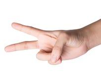 Female hand on white , scissors roshambo sign Stock Images