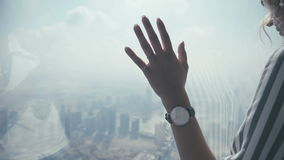 Female hand with a wristwatch on the glass: viewing platform stock footage
