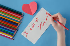 Female hand write love you words in notebook Stock Photography