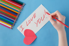 Female hand write love you words in notebook Royalty Free Stock Photo