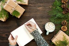 Female hand writes Christmas letter royalty free stock images