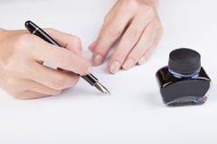 Female hand writes Royalty Free Stock Photos