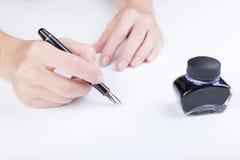 Female hand writes Stock Photography
