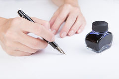 Female hand writes Royalty Free Stock Images