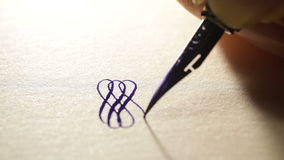 Female hand writes a pen calligraphic signs stock video footage