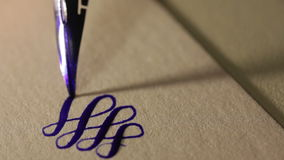 Female hand writes a pen calligraphic signs stock footage