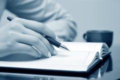 Female hand writing Royalty Free Stock Image