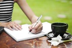 Female hand writing. stock images