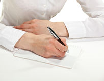 Female hand writing down notes Stock Photos