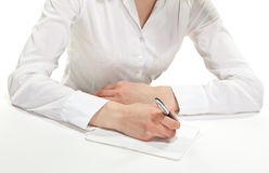 Female hand writing down notes Royalty Free Stock Image