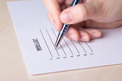 Female hand writing her wish list Royalty Free Stock Images