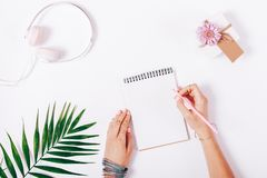 Free Female Hand Writing In A Notebook With Pink Pencil Stock Photos - 107703513