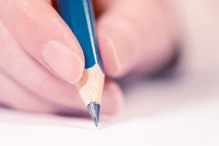 Female hand writing, macro shot Royalty Free Stock Image