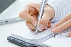 Female hand writing notes Royalty Free Stock Image