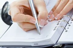 Female hand writing notes Royalty Free Stock Photo