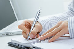 Female hand writing notes Royalty Free Stock Images