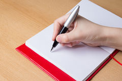 Female hand writing in notebook Stock Photography