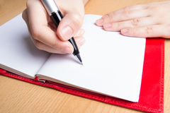 Hand writing in red notebook Royalty Free Stock Image