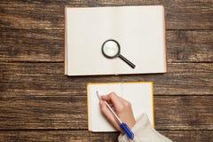 Female hand writing something Royalty Free Stock Photos